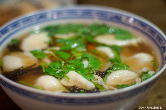 Hot and sour pork dumpling soup ($6.25) is a lightly spicy and tart broth with dumplings that were comforting but lacked a pork flavor.