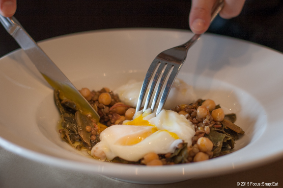 Poached eggs with lentils, chickpeas, ham hock and collard greens ($20)