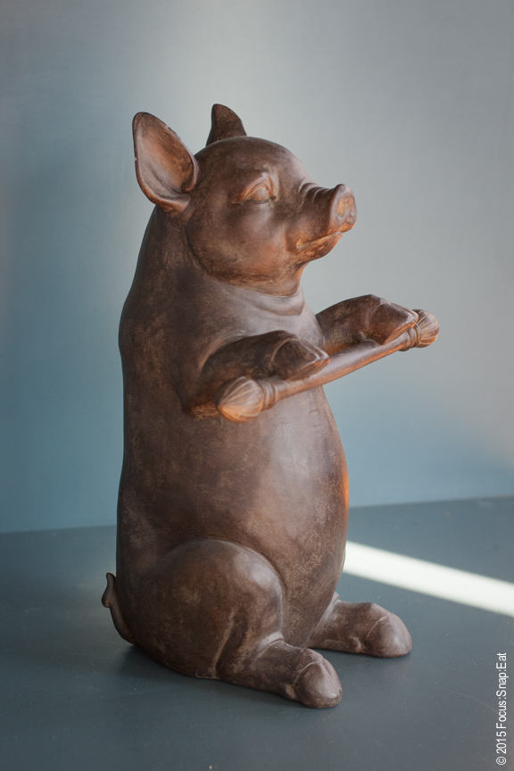 A sculpture of what looks like a dancing piglet.