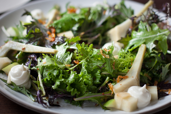 A large and refreshing plate of the mustard green salad ($10) with smoked curd, apple, artichoke, honey, ume, and crispy alliums.
