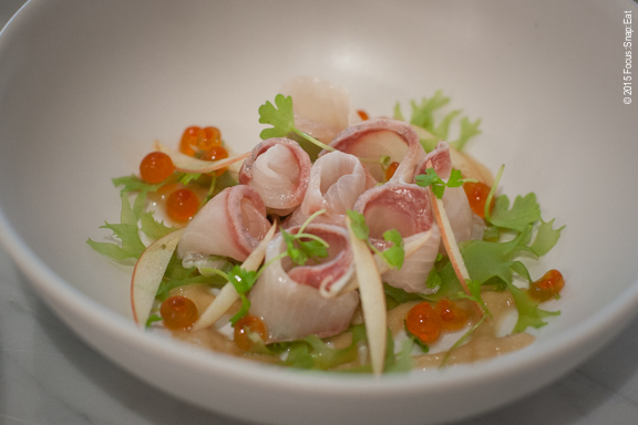 Kanpachi ceviche ($17) made with serrano pepper, ikura, apple slices and micro celery.