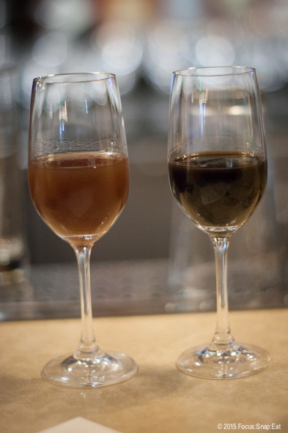 Housemade nocino (walnut liqueur) on the left and fig liqueur on the right.