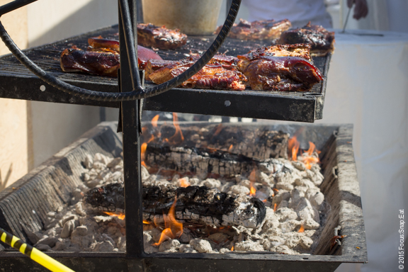 Faultline Brewery got a lot of people's attention with this pit grilling up slaps of pork belly.