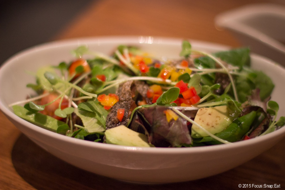 Salmon skin salad ($6.95) with avocado and field greens.