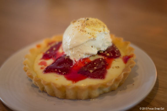 Meyer lemon tart with strawberry and lavendar ice cream is a classic combination ($8)