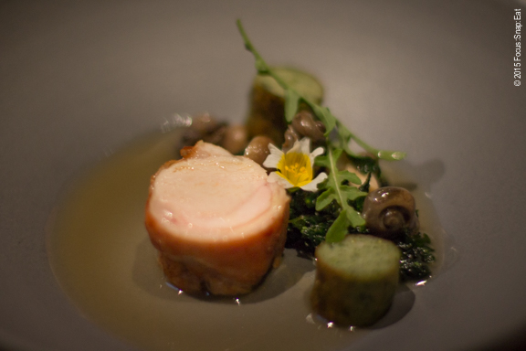 Rabbit served two ways (as a sausage and as a loin cut), with snails, stinging nettles, and green garlic