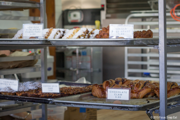 Trays of freshly baked pastries. When you go early, you won't be able to choose from all the selections.