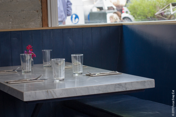Cozy booths with marble tabletops.