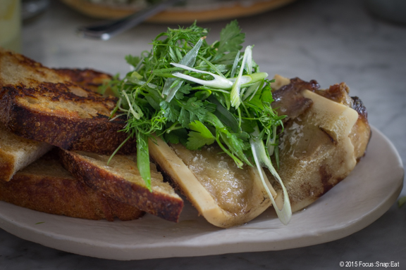 Bone marrow with persillade (parsley sauce) and levain bread slices ($13)