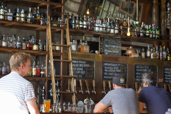 The large bar serves up 15 to 20 Magnolia beer on tap as well as whisky and cocktails.