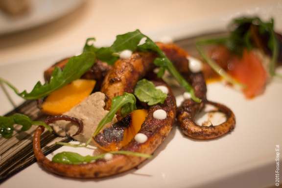 Octopus a la plancha ($21) with smoked garbanzo beans, arugula, peaches, and strawberry-tomato chutney