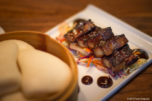 Pork belly buns with sesame honey glaze and pickles at ChoLon