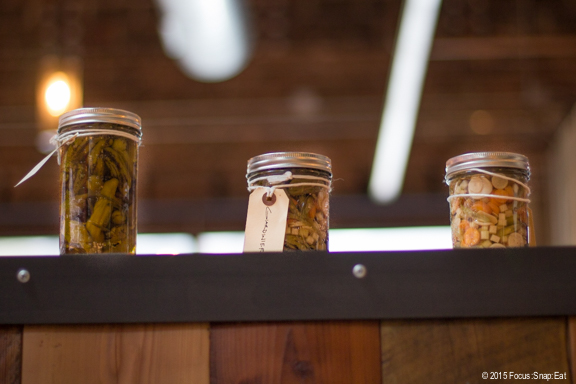 Pickles in jars line the room and shelves around the dining room.