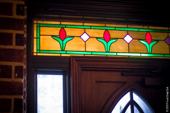Stained glass artwork above the doorway