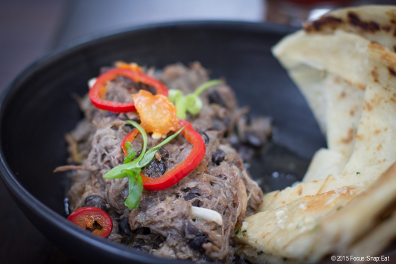 Kalua pork shoulder with curried black beans, roti flatbread, and pickled jalapeno ($13). I felt it needed more salt and less moisture.