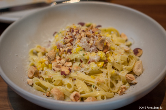 Tagliatelle with sweet corn, pancetta, reggiano, and hazelnuts ($16)