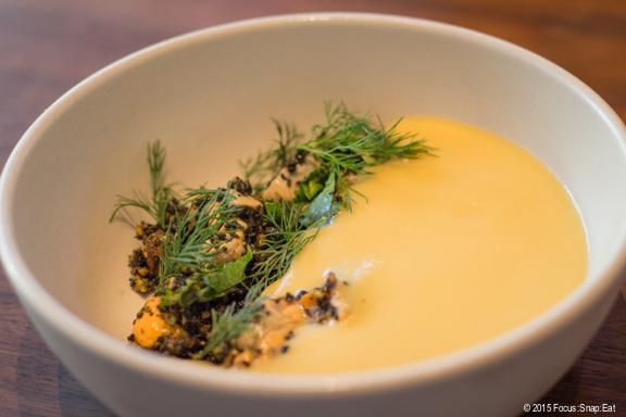 First course of chilled golden beet soup with mussels, pistachio and dill ($12)