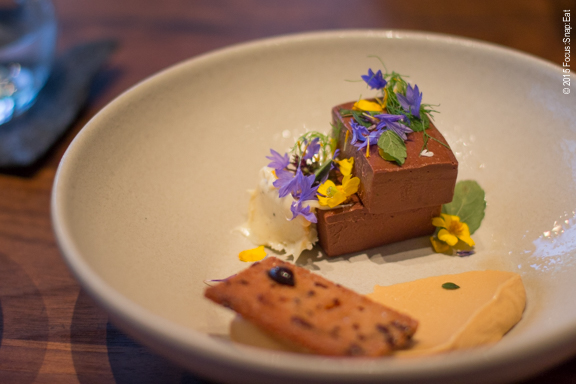My favorite dish of chocolate ganache beautifully presented with edible flowers and served with a black caramel ice cream and cocoa nib. There was an added touch of cream that was almost like cream cheese, providing a nice bitterness to the ganache. ($12)