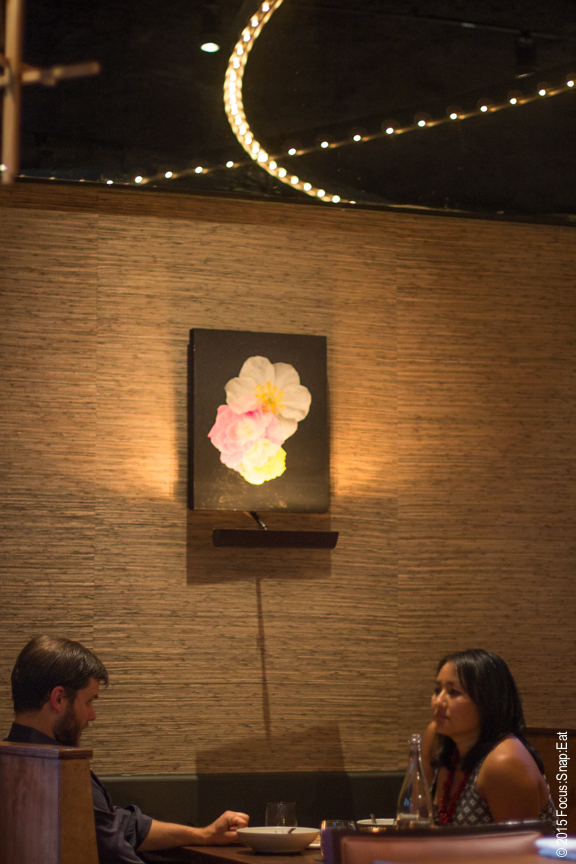 The intimate room at Aster features paintings of flowers that are also represented on its website.