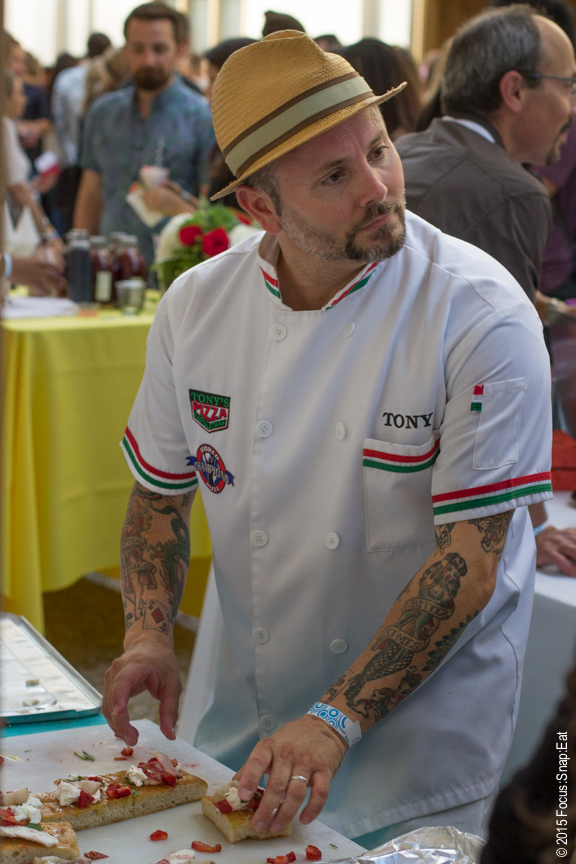 "Noted pizzaiolo and restaurateur Tony Gemignani was on hand to serve up his ""Farmer's Focaccia"" topped with pluot and strawberry relish, hand-pulled mozzarella, strawberry oro blanco shrubs, fromage blanc, and basic cream."