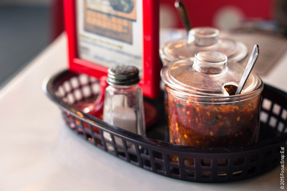 Tableside tray of chili and other condiments.