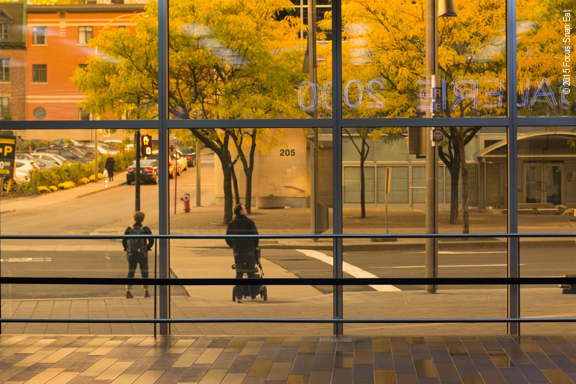 Fall colors through tinted glass at the Montreal convention center known as the Palais de Congress.