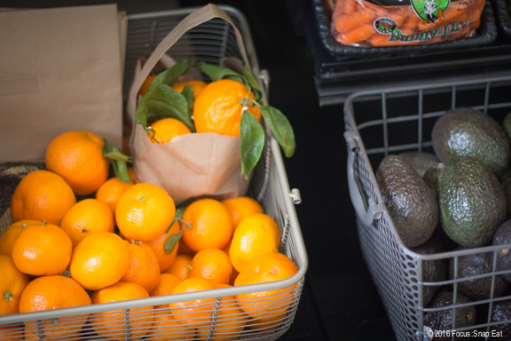 Oranges and avocados for sale in the small produce section.