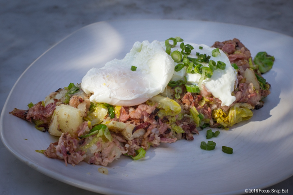 Corned beef hash with poached eggs and Brussels sprouts