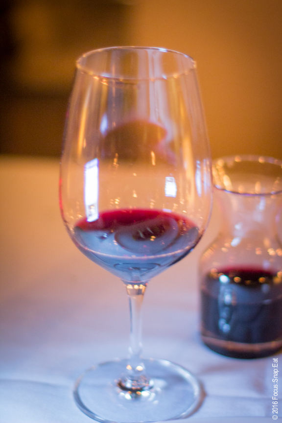A glass of E3, a blend of three types of Spanish wine