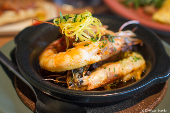 Juicy Gambas al ajillo, or sauteed garlic prawns, Spanish olive oil, crispy garlic flakes, $14