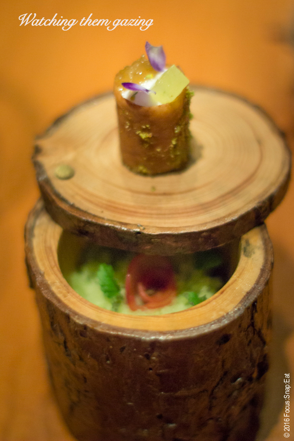 French pastry on top of a stump container with granita