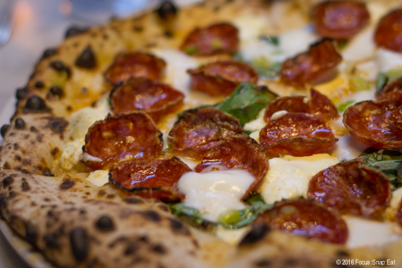 Bianca pizza with salami piccante