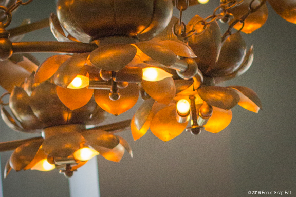 Gold plated light fixture at the new Mister Jiu's