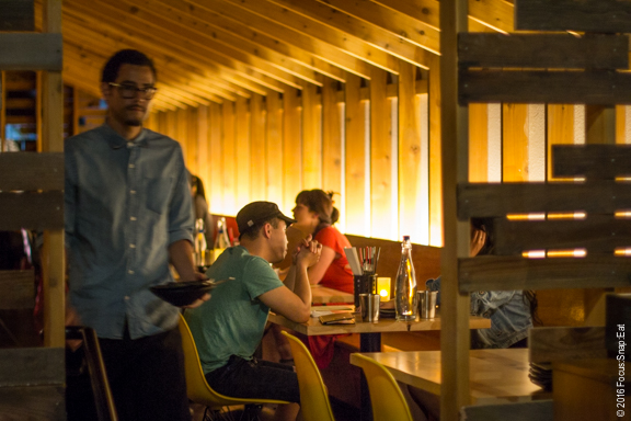 The modern A-frame section of the dining area provides a more cozy spot to dine.
