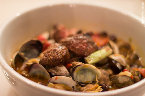 Manila clams with lamb merquez sausage, lamb skewer, wood-fire piperade and cannellini beans, $24.