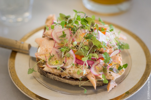 Open-faced trout sandwich with radishes and trout roe