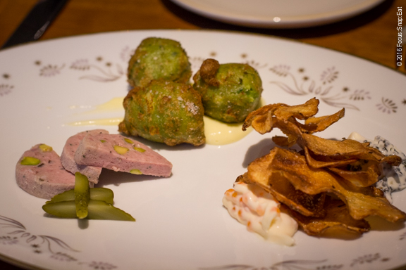 Dinner starts with snacks that included house-made pate, croquettes, and thin potato chips with caviar creme fraiche.
