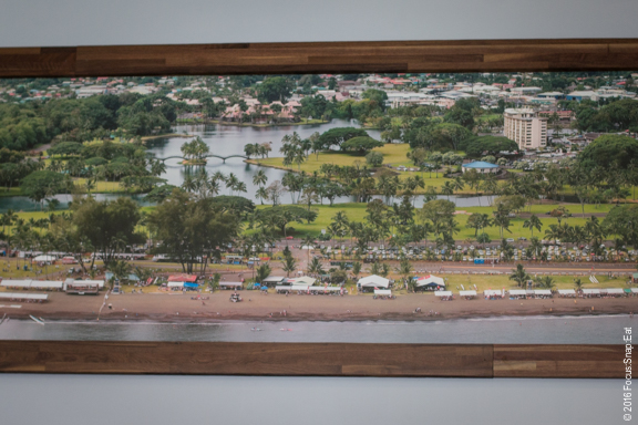 A large painting above the bar depicts the Ala Wai Canal on Oahu.