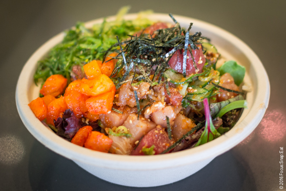 """Arlene's bowl with """"the works,"""" using all nine available toppings from pickled pineapples to seaweed salad."""