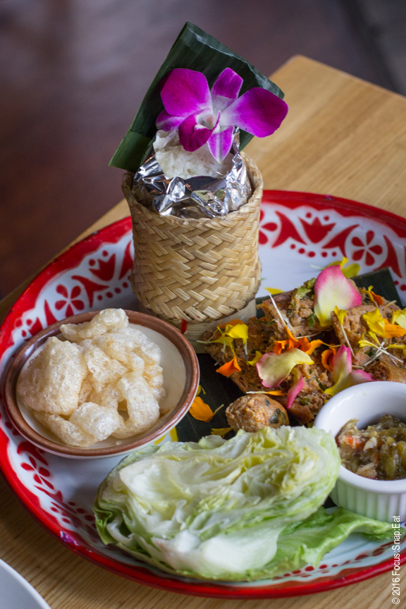 Sai Ua and Namprik Noom ($13) or grilled Northern Thai chicken sausage with spicy young pepper relish, pork cracklings and sticky rice with lettuce for wraps
