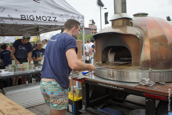 This pizza oven was in the center of the food stands but most people were buzzing about this guy's summer shorts. ;-)