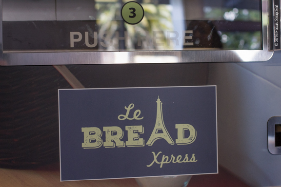 Machine dispensing French baguettes.