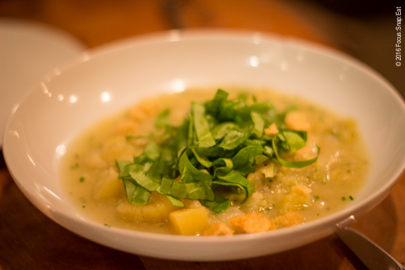 Potato and leek soup with sorrel and croutons, presented in a rustic manner. ($12)