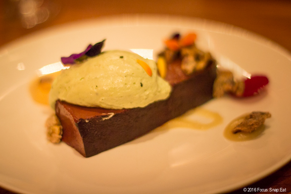 Chocolate pate with matcha cream, pistachio and quince.