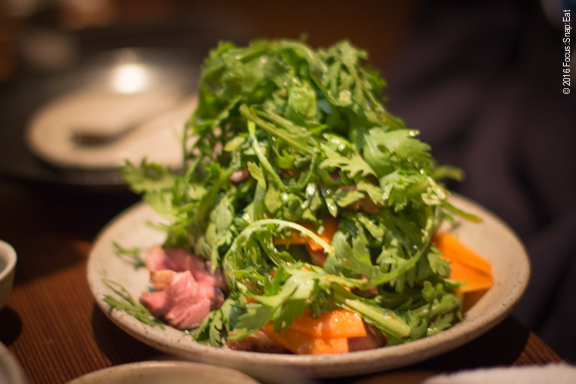Shungiku kamo sarada is a salad of chrysanthemum greens with grilled Sonoma duck and persimmon.