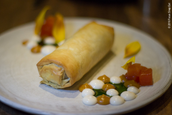 Basteeya filled with duck and served with persimmons, marigold, creme fraiche and almond, $22.