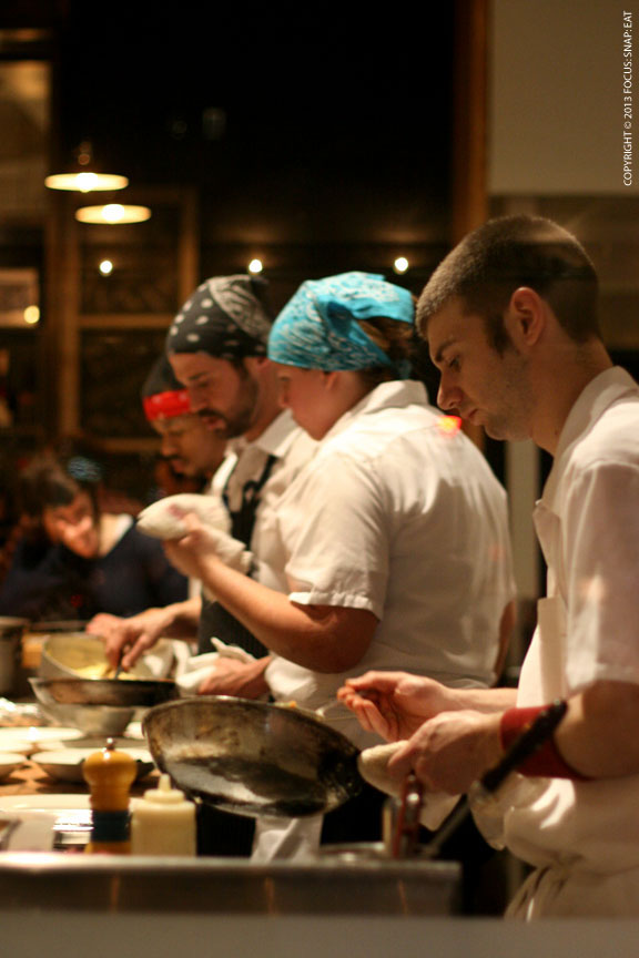 View of the chefs at work at the open kitchen