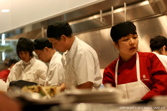 The busy line prepping dishes before they head to the tables