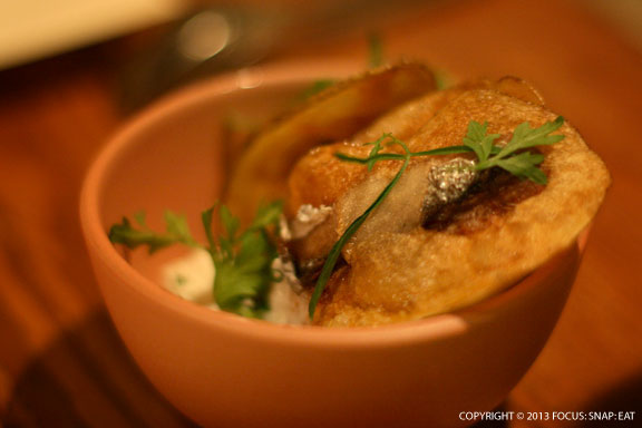 Sardine chips ($7) is a signature starter where a sardine is woven into thinly sliced potatoes