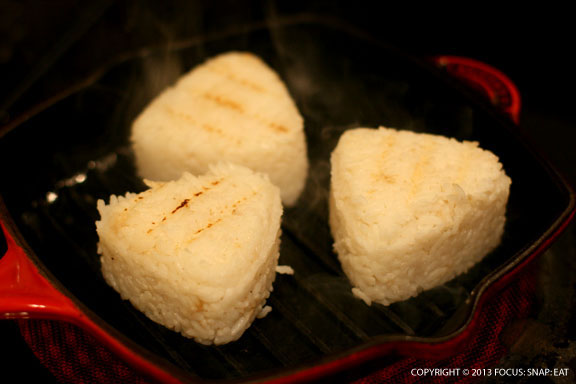 Grilling the rice balls on a grill pan that's been lightly wiped with oil